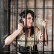 Portrait of Sneering Female Prisoner — Stock Photo #39260623