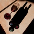 ������, ������: Wine Bottles and Wine Glass with Dramatic Shadow
