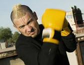 Punk Businessman with Boxing Gloves — Stock Photo