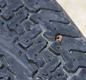 Tire with a nail — Stock Photo