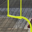 Stock Photo: Goal Posts and Empty Stands