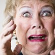 Stock Photo: Horrified Senior Woman