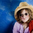 Stock Photo: Mad Girl in a Hat and Glasses