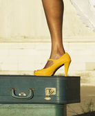 Leg and shoe on a suitcase — Stock Photo