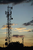 Communications Tower and Power Lines — Stock Photo
