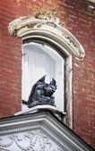 Gargoyle on on Old House — Stock Photo