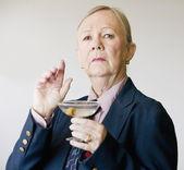 Dramatic Senior Woman with a Martini — Stock Photo
