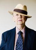 Dramatic Senior Woman Wearing a Hat — Stock Photo