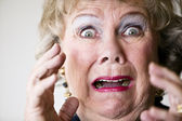 Horrified Senior Woman — Stock Photo
