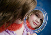 Little Girl Looking a Mirror — Stock Photo