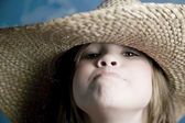 Little girl with a straw hat — Stock Photo