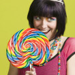 Young punk woman with a big lollipop — Stock Photo #39451715