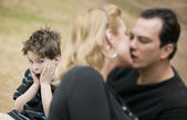 Kissing Adults and Horrified Boy — Stock Photo