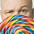 Man Peeking Out From Behind A Lollipop — Stock Photo