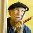 Artist with a Beret at a Canvas looking up — Stock Photo #39602393