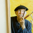 Artist with a Beret at a Canvas — Stock Photo #39602395