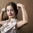 Young Woman Flexing Her Biceps — Stock Photo