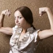 Stock Photo: Young Woman Flexing Her Biceps
