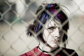 Punk Girl Behind Chain Link — Stock Photo