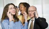 Three Businesspeople on Cell Phones — Stock Photo
