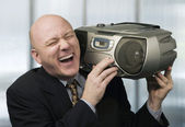 Businessman with Boom Box — Stock Photo