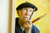 Artist with a Beret at a Canvas looking up — Stock Photo