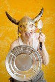 Crazy Old Man in a Viking Helmet — Stock Photo