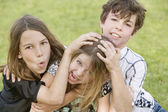 Sibling Playing Roughhouse — Stock Photo