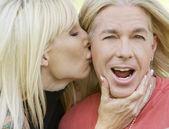 Woman kissing a man — Stock Photo