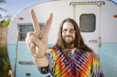 Man in Front of a Trailer Making a Peace Sign — Stock Photo