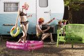 Women outside a trailer — Stock Photo