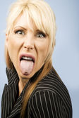 Woman sticking out her pierced tongue — Stock Photo
