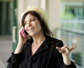 Modern Businesswoman on a Cell Phone — Stock Photo