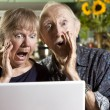 Stock Photo: Shocked Senior Couple with Laptop Computer