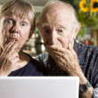 Stock Photo: Perplexed Senior Couple with Laptop Computer