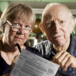 Elder Couple with Bills — Stock Photo #39612351
