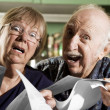 Stock Photo: Elder Couple with Bills