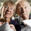 Elder Couple with Bills — Stock Photo #39612393