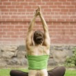 Woman with a Tattoo on Her Back Doing Yoga — Stock Photo