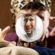 Stock Photo: Gyspy seen in crystal ball