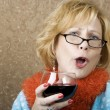 Stock Photo: Funny WomDrinking Wine