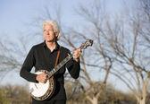 Banjo Player Outdoors — Stock Photo