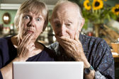 Perplexed Senior Couple with a Laptop Computer — Stock Photo