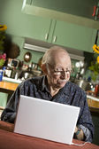 Senior Man with a Laptop Computer — Stock Photo