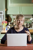Senior Woman with a Laptop Computer — Stock Photo