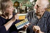 Portrait of Senior Couple with Pill Case — Stock Photo