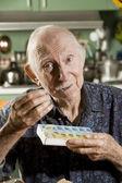 Elder Man with a Pill Case — Stock Photo