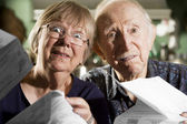 Elder Couple with Bills — Stock Photo