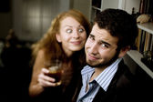 Woman Leers at Man at Party — Stock Photo
