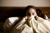 Frightened Woman in Bed — Stock Photo